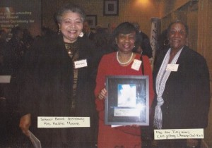 Photo of Pearl Prince Holding Society of Innovators Award (400x281)